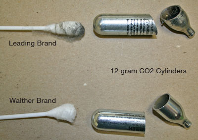 Bad airgun CO2 cartridge has oil grit and coating inside, while good CO2 capsule is very clean.